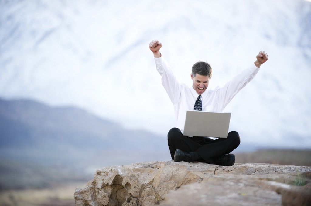 iStock_12573288LG happy man laptop rock
