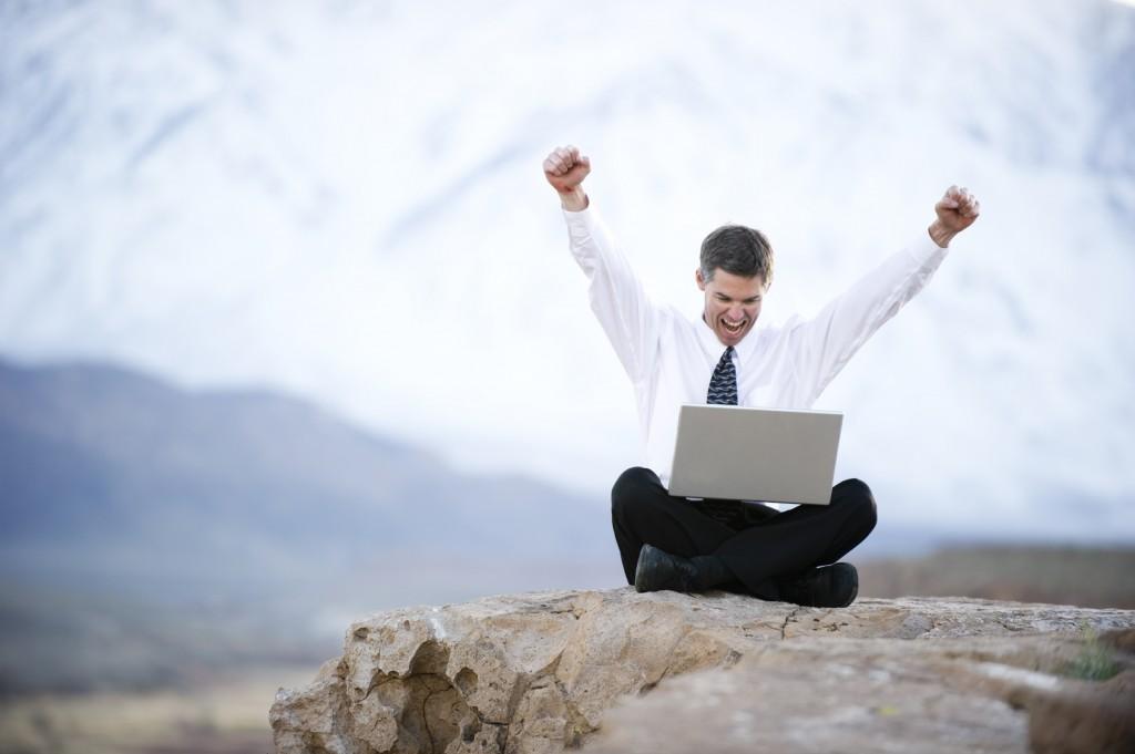 iStock_12573288LG happy man laptop rock